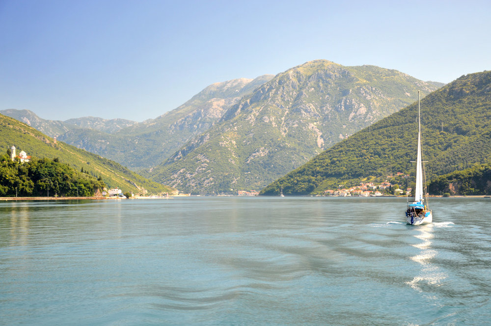 A boat sailing in the Bay of Kotor near Herceg Novi