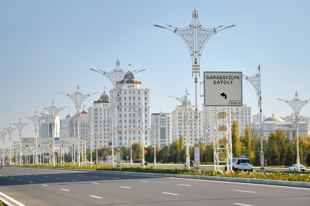 Wide road and white marble buildings in the city center