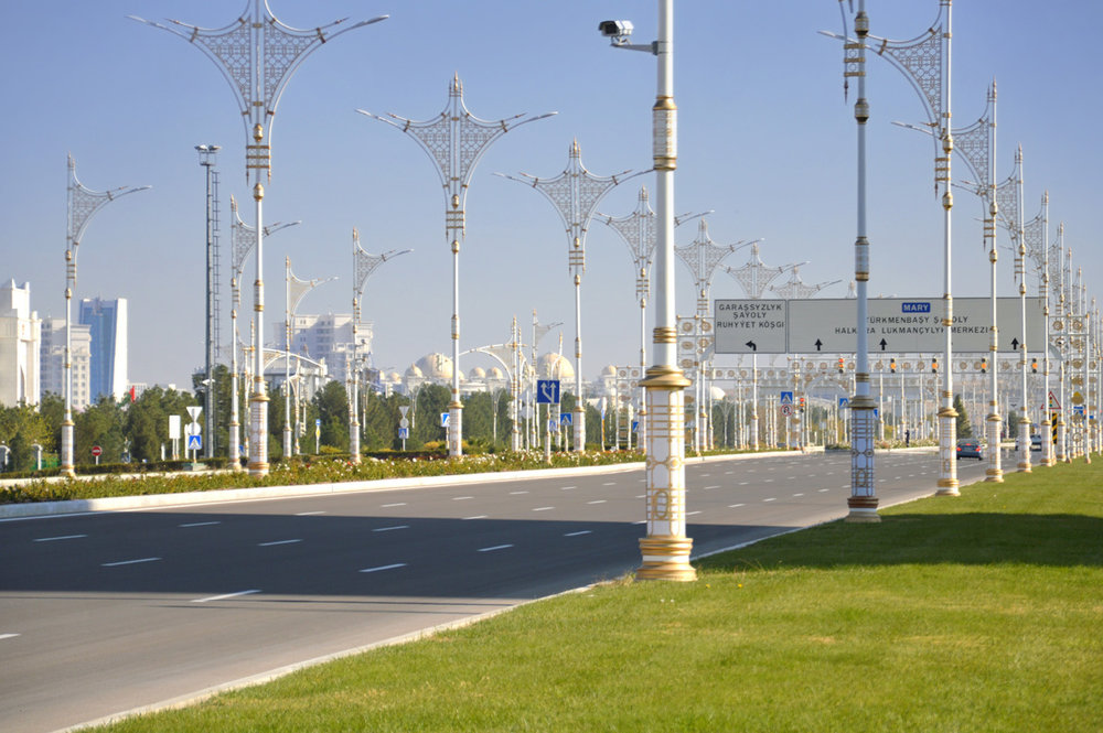Perfect row of white street lamps