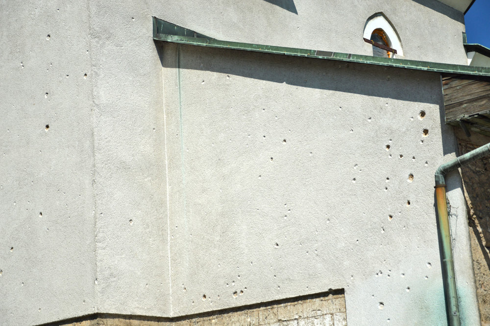 Bullet marks on the walls of the mosque