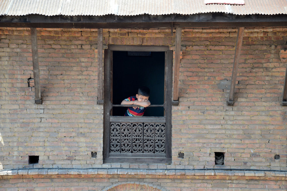 A child looking out of the window