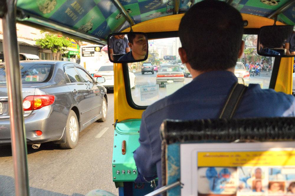 Tuk-tuk ride between the cars