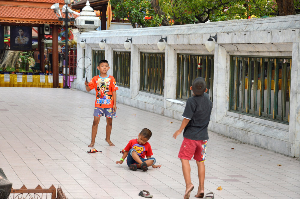 Children playing at Wat Intharawihan