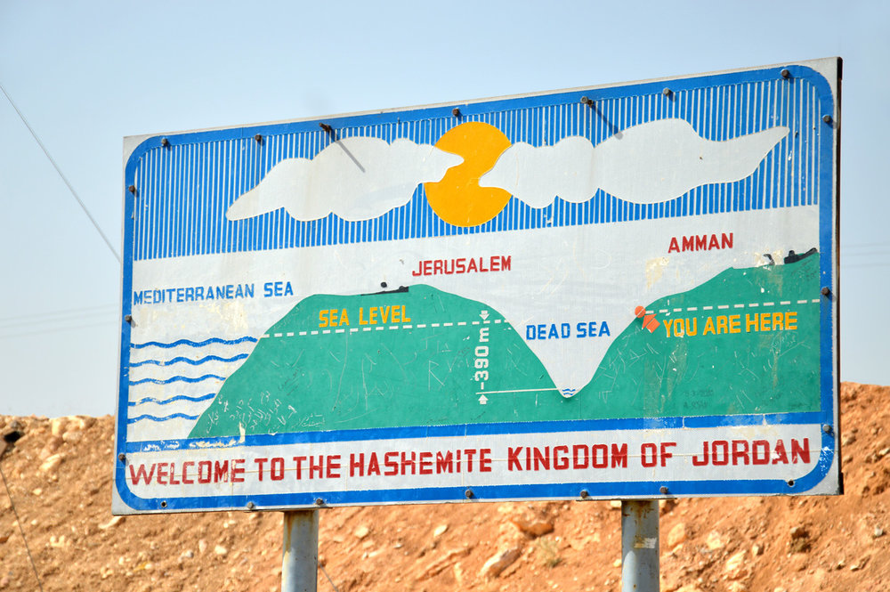 The sign showing Dead Sea in relation to Mediterranean Sea
