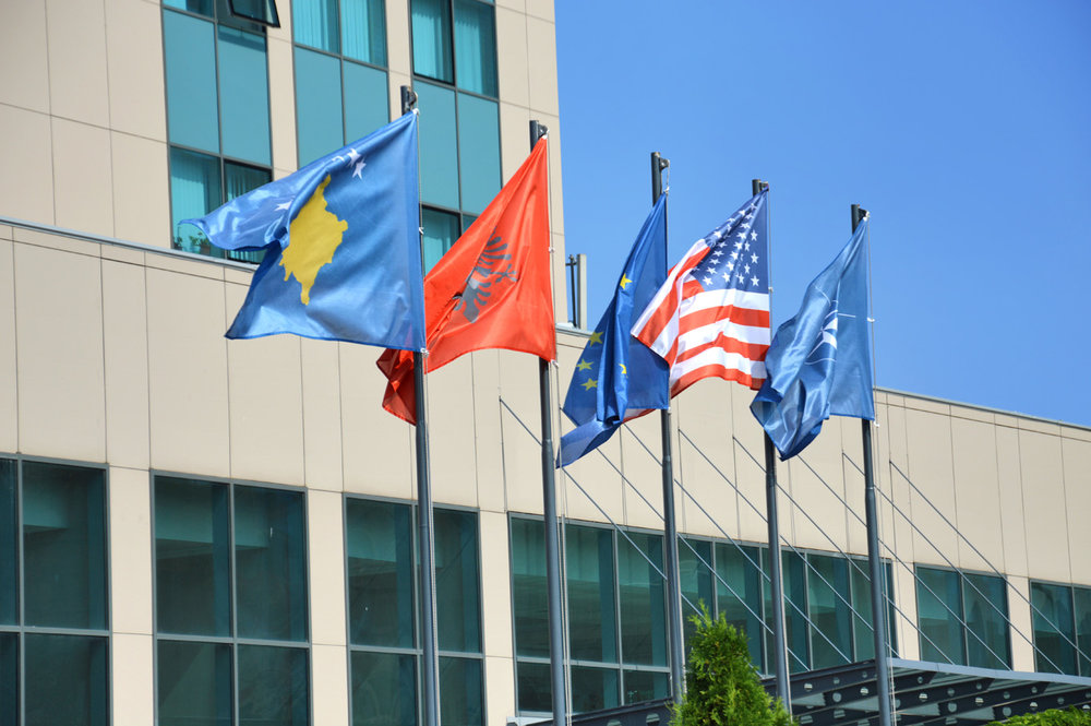 Kosovo, Albania, EU an the US flags