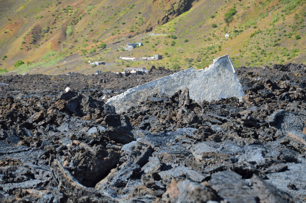 Destroyed Cha das Caldeiras village - a fragment of a house sticking out of the lava field