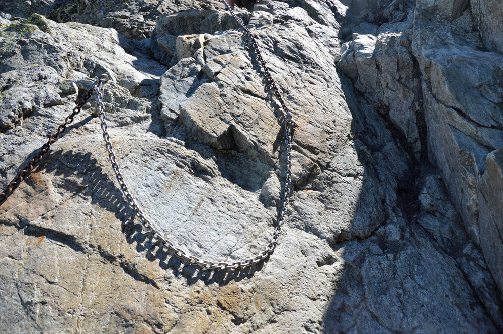 Chains attached to a vertical rock
