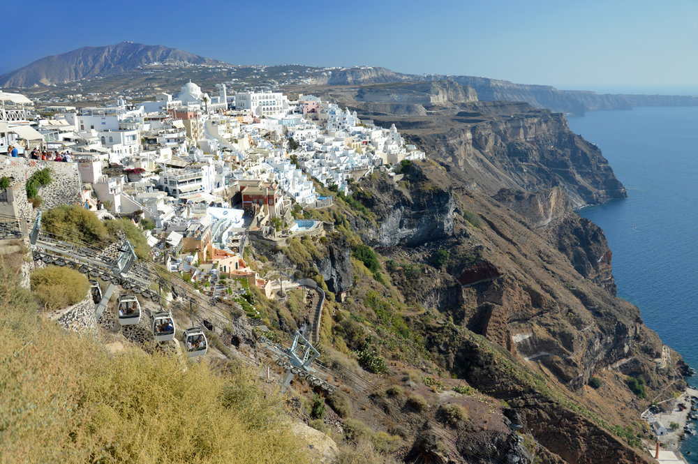 Whitewashed houses on black volcanic cliffs