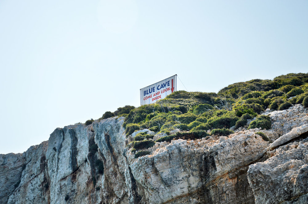 Blue Caves sign