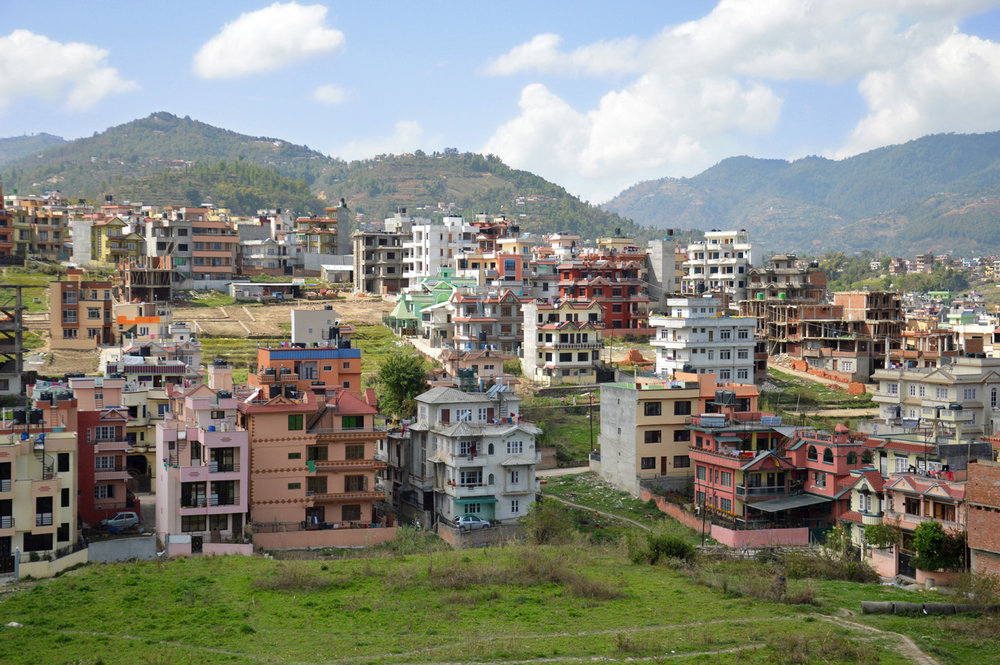 New houses on the hills around