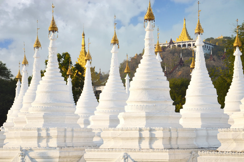 White stupas of Sandamuni Pagoda - Mandalay Hill in the back