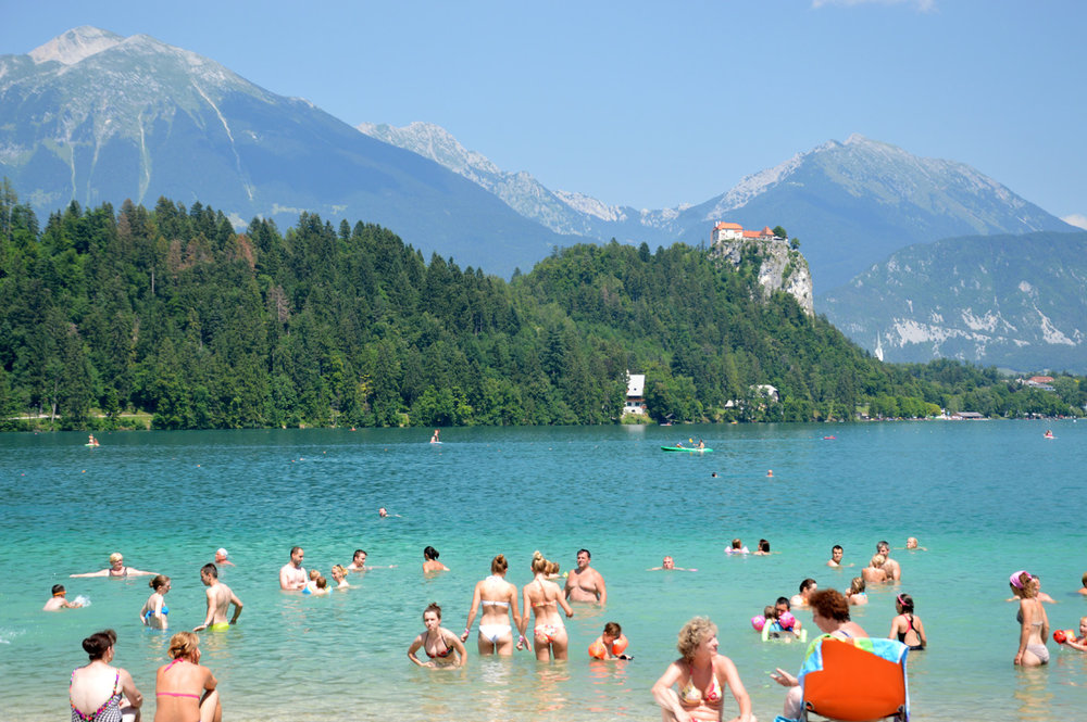 People enjoying swimming in Bled