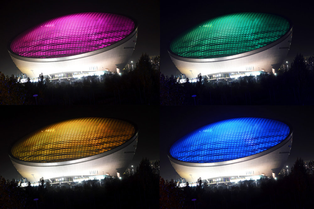 Nazarbayev center at night - illuminated with different colors