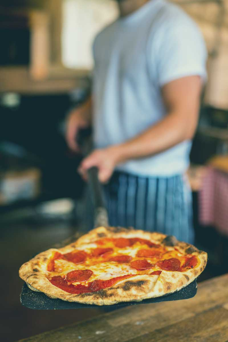 We've got a wood-fired pizza oven knocking out beautiful food!