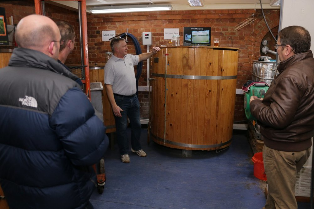 Ray, Director at Towcester Mill, giving a brewery tour over the Mill's Hot Liquor Tank.