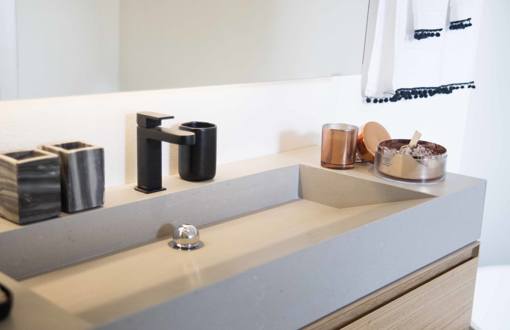 custom designed vanity and Matt black tap with marble and copper finish accesories
