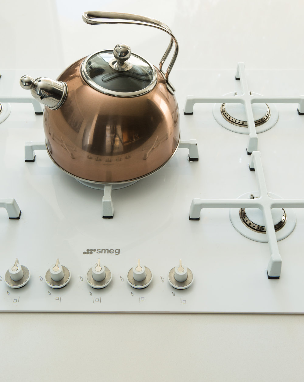 Linear range by SMEG and copper kettle