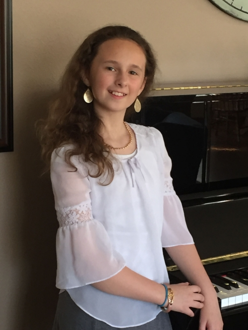 Isabella is a spunky and sparkling 5th grader at Pioneer Elementary,  who does her best in everything she puts her mind to!  A totally creative type, she loves writing, composing music and reading great books.  She and her two big brothers have formed a trio called the Swords and Shields Trio!