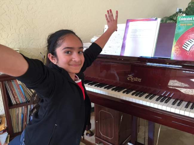 Viveka is a vivacious 6th grader who excels at school, music, and at the gym! Besides piano, she also plays cello, dances and has been a competitive gymnast. She can even do splits on the piano bench!