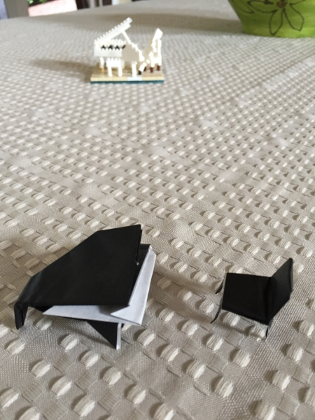 The black piano and bench is an origami design he found online.