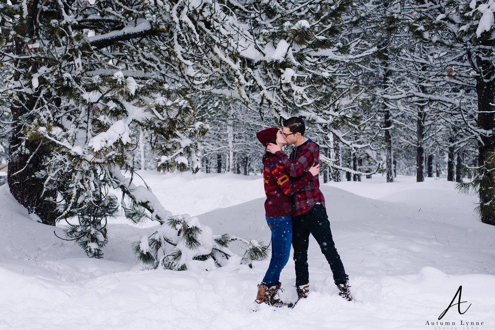couple-kissing-snow-ponderosa-park-mccall-idaho