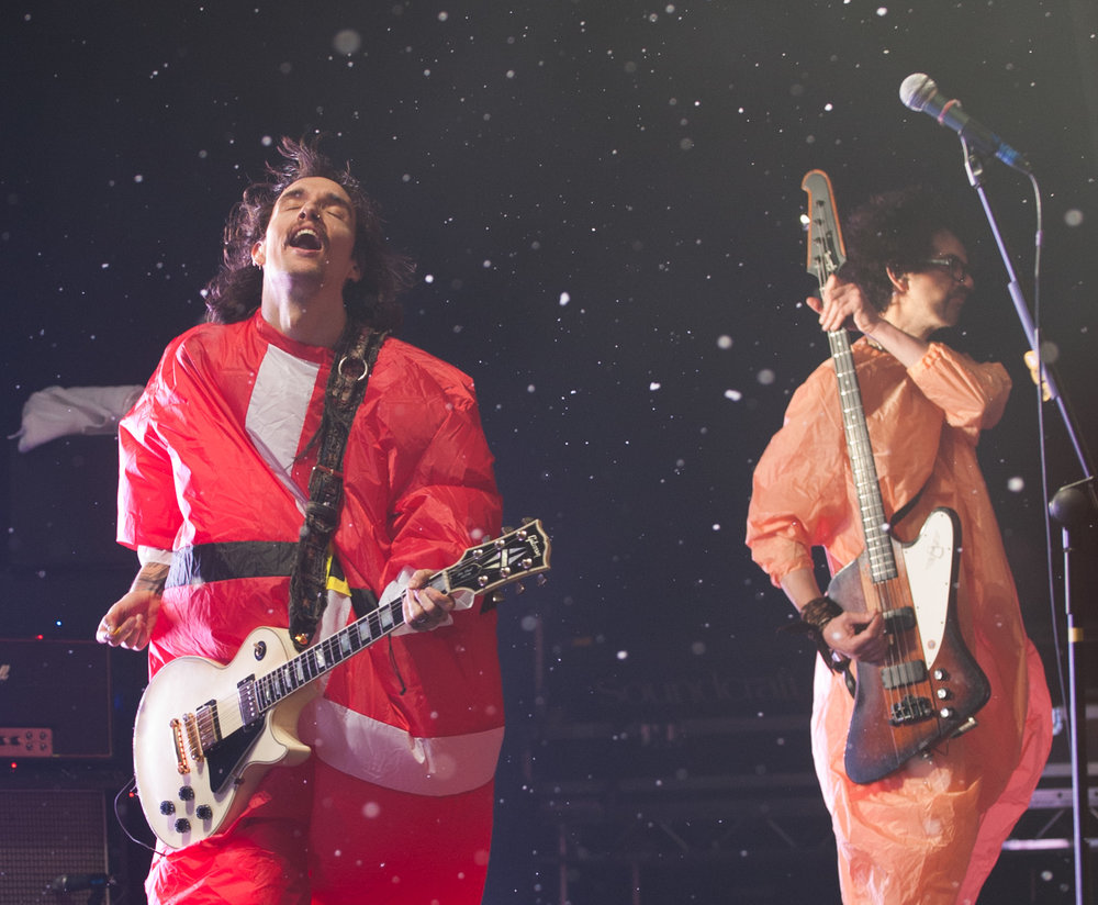 The Darkness perform as snow falls on stage.jpg
