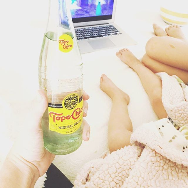 They get to watch frozen with popcorn in bed and I get #topochico. I must officially live in Austin. I mostly wanted to post this to remember Remi's little toes and Ry's faint right thigh birthmark #hearteyes 😍🍿🎥