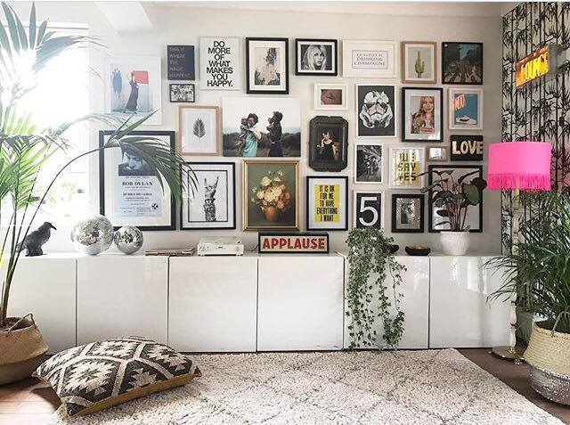 Gallery wall by  Lisa Dawson Styling . I love the mismatched frames and prints above these Ikea storage units, they have been cleverly planned and laid out to create a full gallery wall, each print fits into its own planned space all accessorised with a hint of shocking pink and greenery.