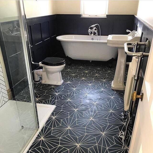 Ok so I have serious tile-envy over Katie from  Comedowntothewoods  bathroom. I love these geometric tiles and they can be laid in different ways to create different patterns. They bring together the white sanitary ware and panelling perfectly and are a great alternative to standard square or rectangular tiles (even if your tiler will hate you!) And you can just make out her shower tiling using simple white tiles set in a herringbone pattern which looks so good!