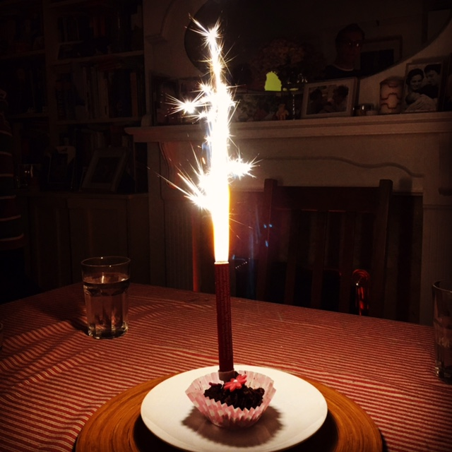 Solitary final birthday cake with a MASSIVE candle!