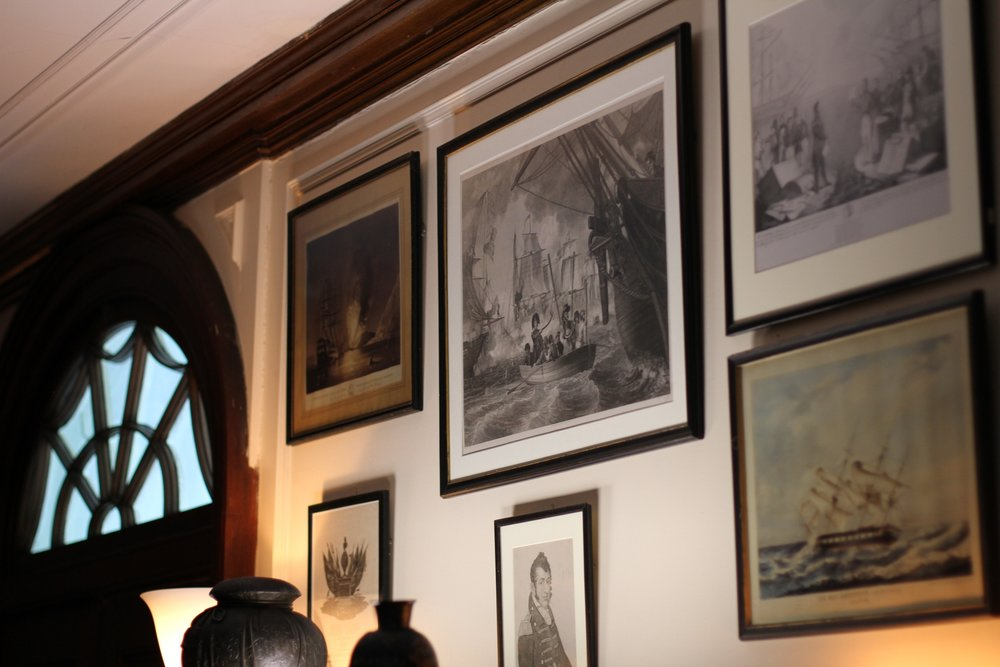 Walls filled with framed pictures and paintings.