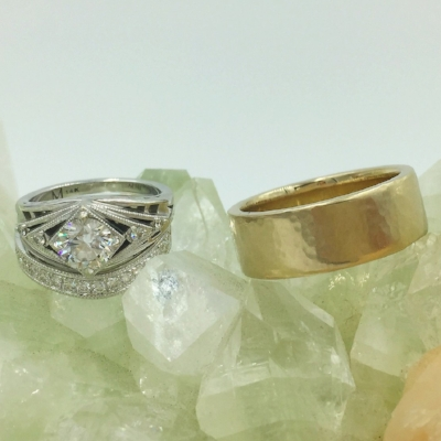 Engagement and wedding ring with diamonds completed alongside Matt's 18k white gold flat hammered band with satin finish.