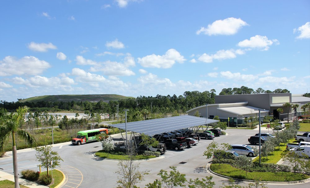Image 2: The solar parking overhang produces solar electricity and keeps the cars below cool.