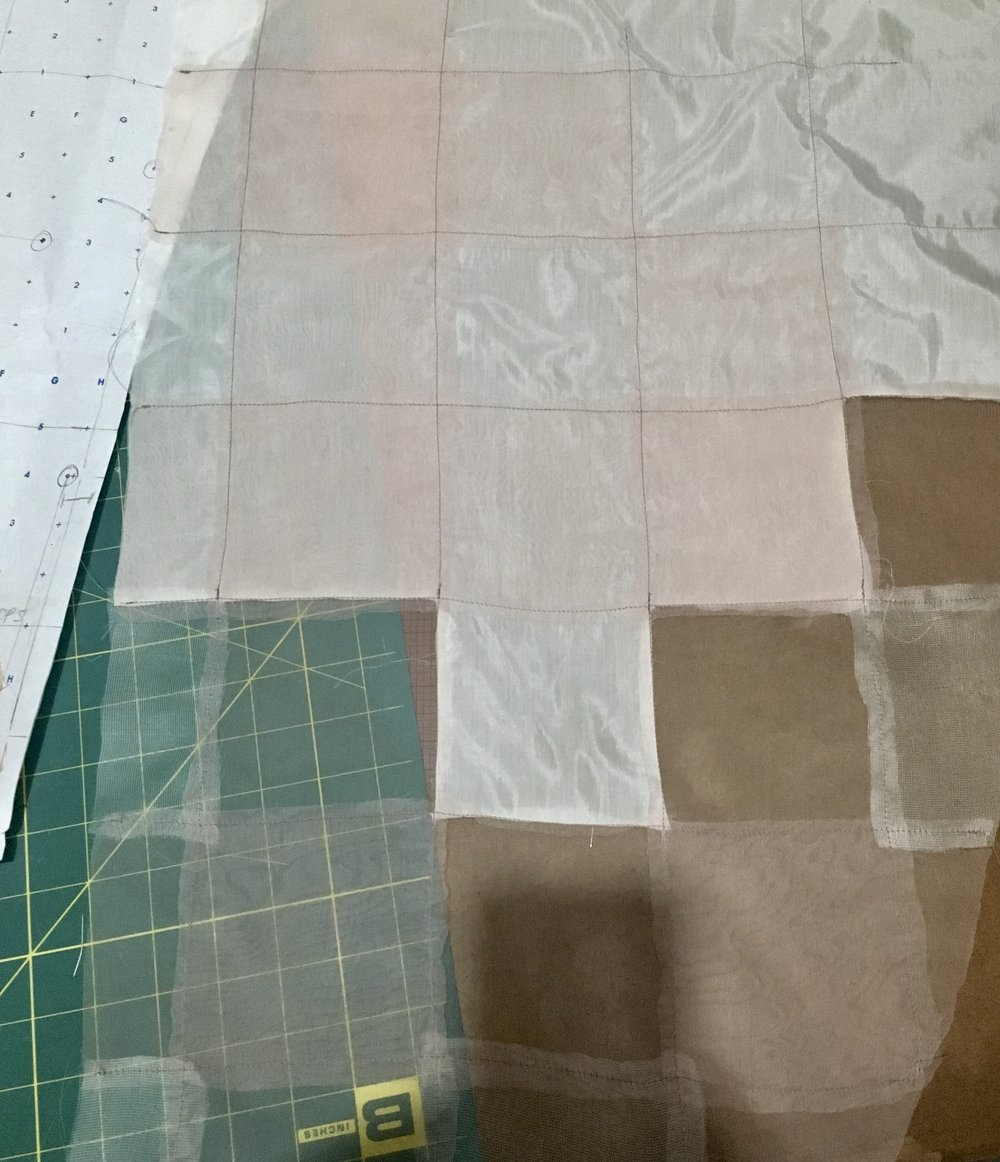 developing a constructed plaid out of mesh, organza, and habotai