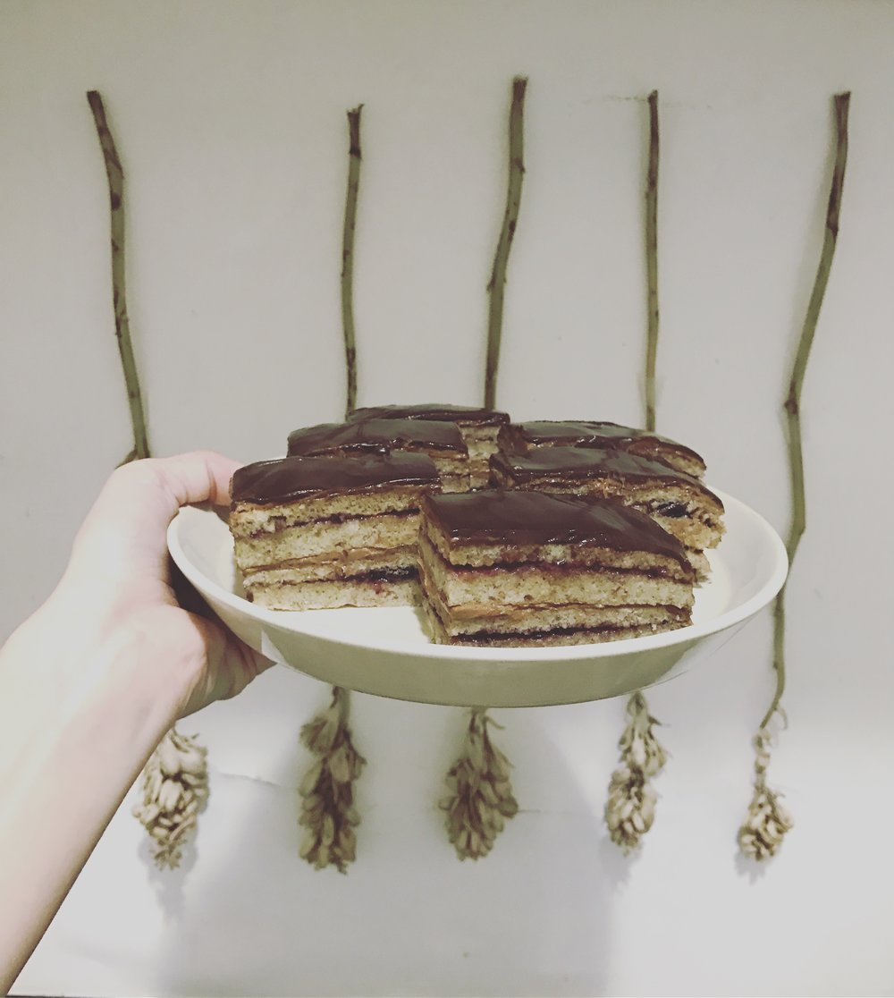 """opera cake"" almond sponge, layered with chocolate buttercream and black currant jam, covered in chocolate ganache. my best yet"