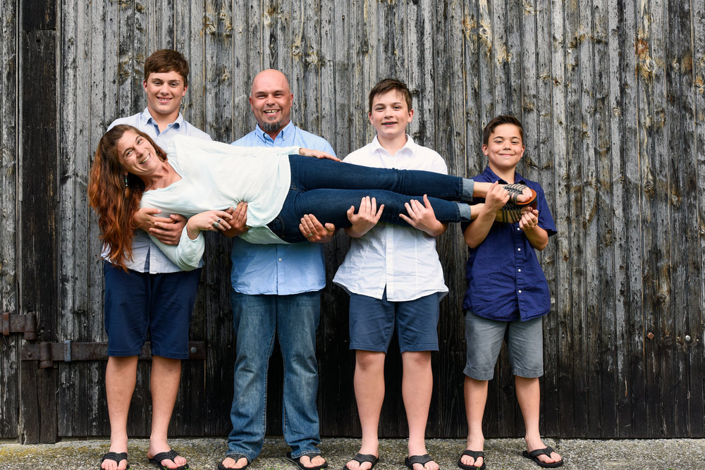 boys holding jenn by barn.jpg