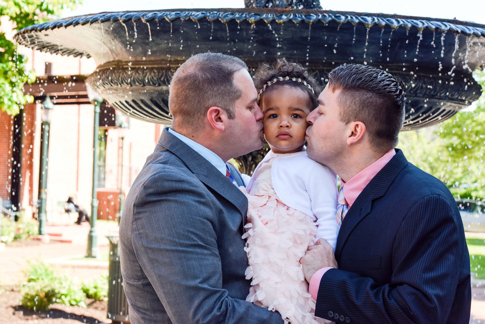 daddies kissing Ava's cheeks.jpg