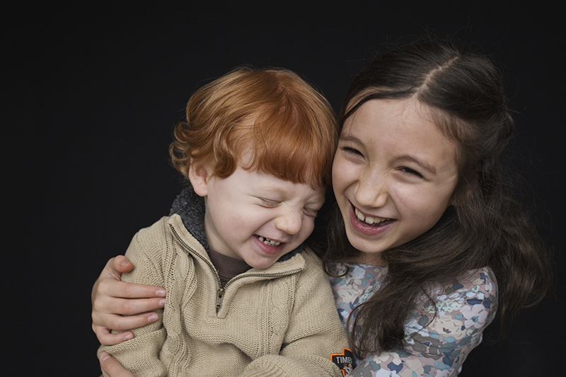 Rochester school photographer siblings laughing together