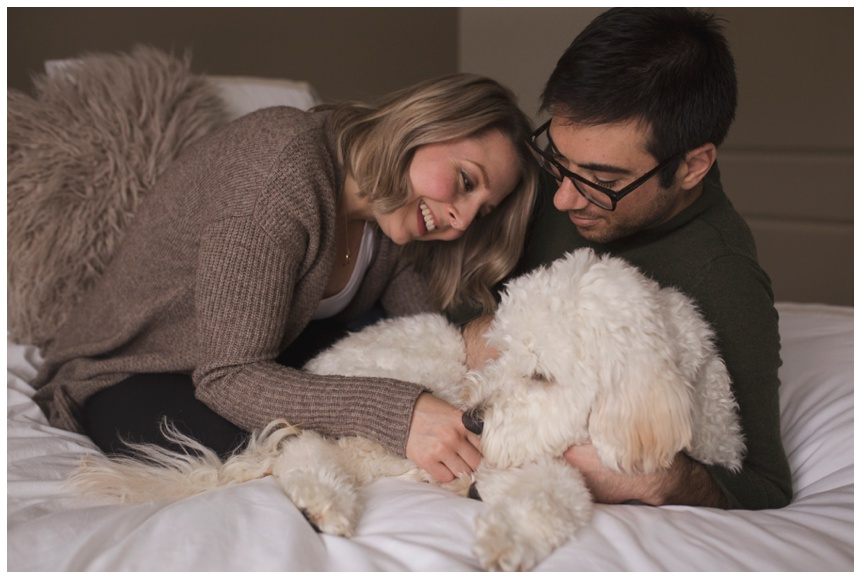 Oneonta NY Maternity Photographer in home session snuggling with dog