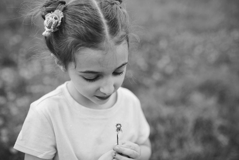 Upstate NY photographer, girl exploring dandolions