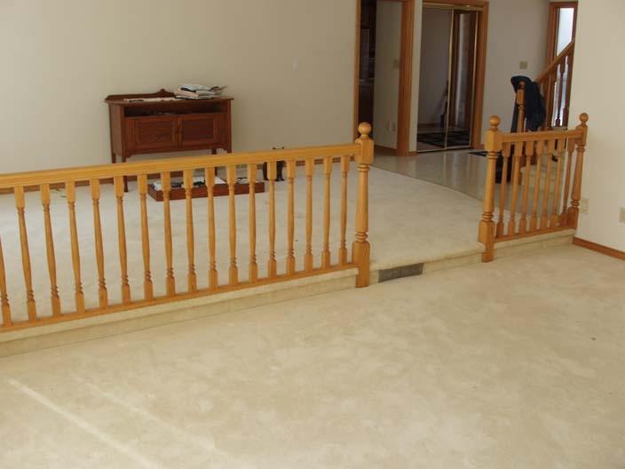House_Renos-oak railing front entrance.JPG