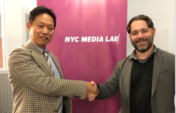 Hakuhodo Executive Manager of R&D Masato Aoki with NYC Media Lab Executive Director Justin Hendrix