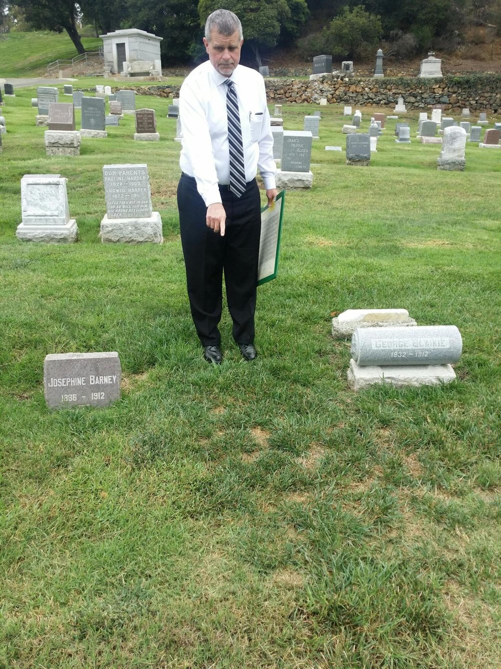 Scott Pennington, the General Manager of Sunset View cemetery in El Cerrito, points to the unmarked grave of Andrew W. Lindquist