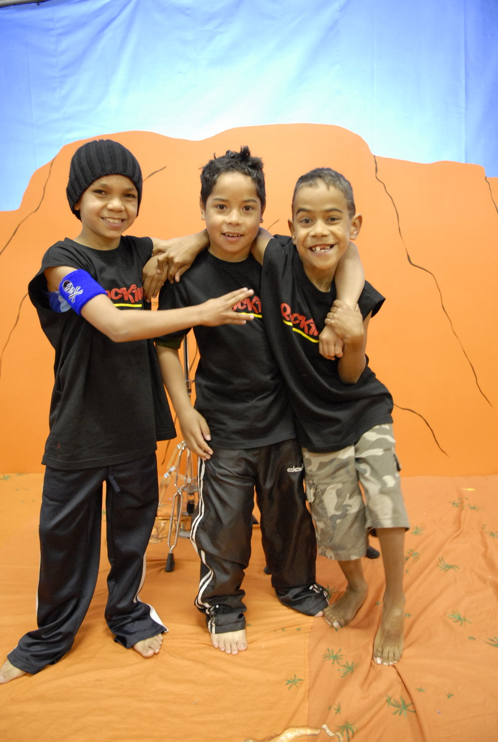 Aboriginal boys enjoying a rap song in front of Uluru prop before the Kangaroo Rock clip