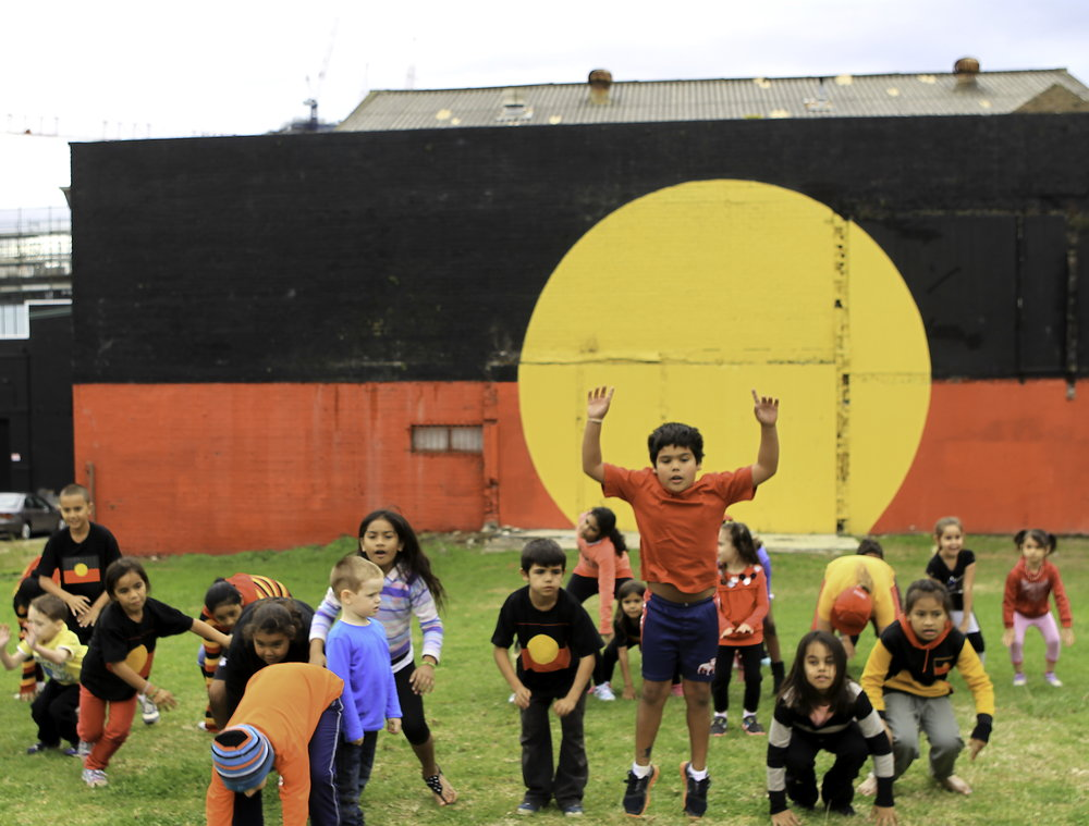 Kids showing pride in Aboriginal culture during NAIDOC