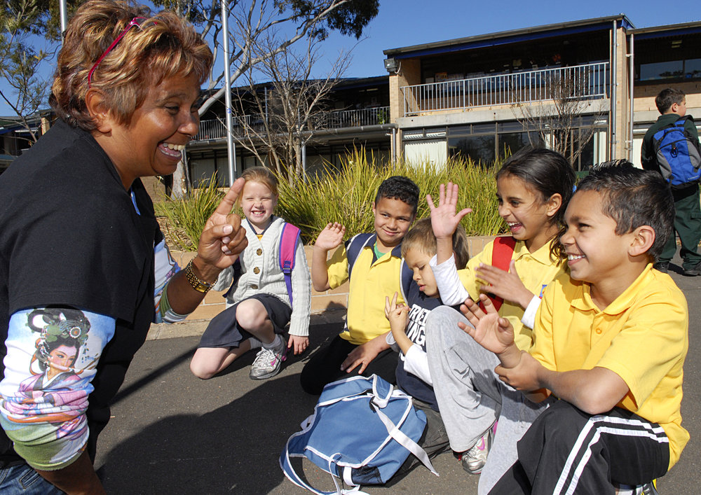 Aboriginal children going to school with Aunty Joy. Health, happy going to school.