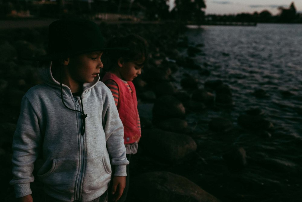kids looking at the lake water