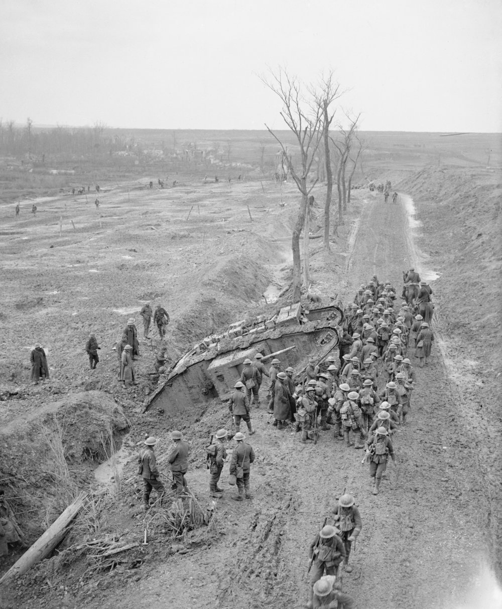 Soldiers gather around a ditched tank near Fampoux, 9 April 1917 John Brooke © IWM Q 6434