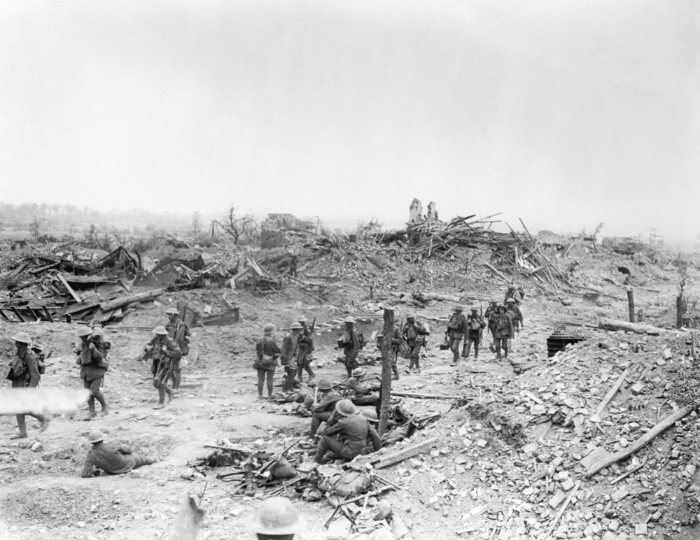 Commonwealth troops move thru ruins of Wytschaete day after capture 8 June 1917