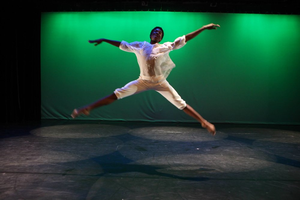 Youth Dancer Boy leaps green background.jpg